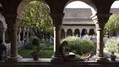 Naomi Cohen, 20, reads in The Cloisters, the