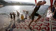 Professional Ironman athlete Dirk Bockel, of Luxembourg, emerges