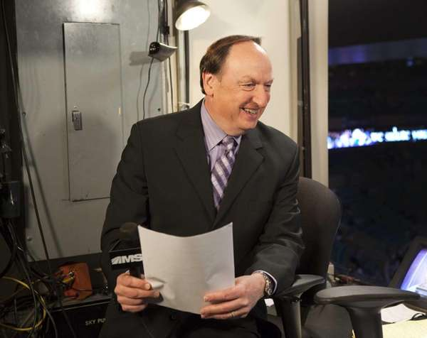 MSG announcer Sam Rosen prepares before a game.