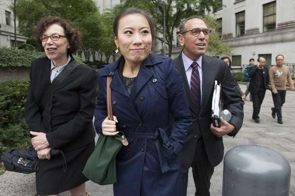 "Jia ""Jenny"" Hou, second from left, exits Federal"