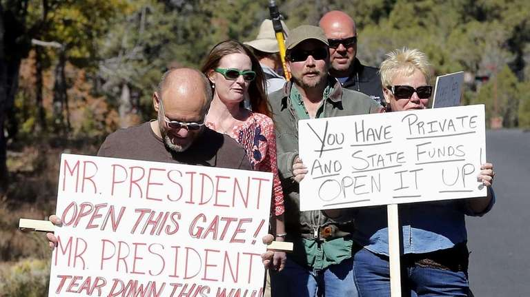 Government shutdown protesters walk to the Grand Canyon