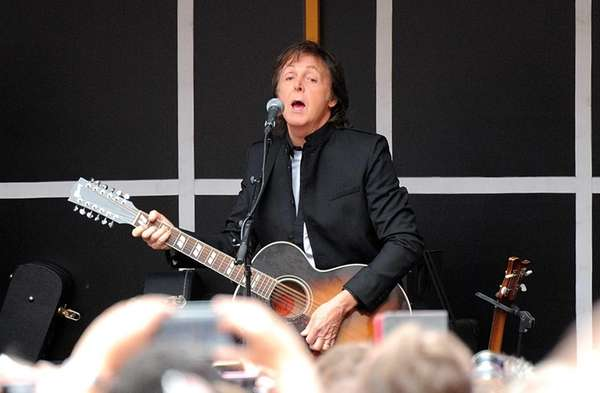 Sir Paul McCartney and his band give a
