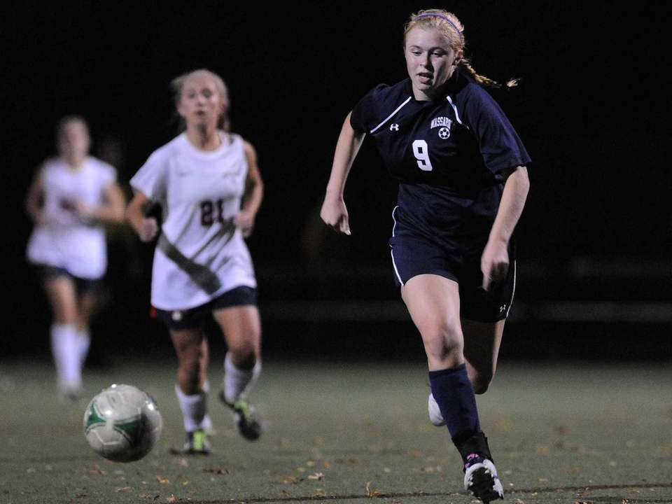 Massapequa'sMackenzie Palmer chases after a loose ball during