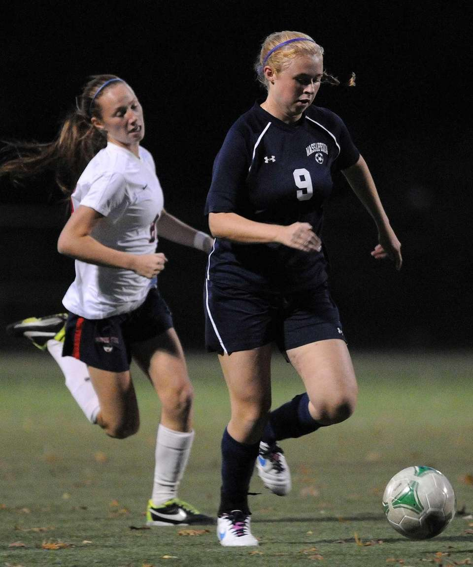 Massapequa's Mackenzie Palmer, right, looks to keep the