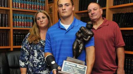 Billy Andrle, center, with his mom Donna, left,