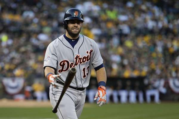 Detroit Tigers hitter Alex Avila walks to load