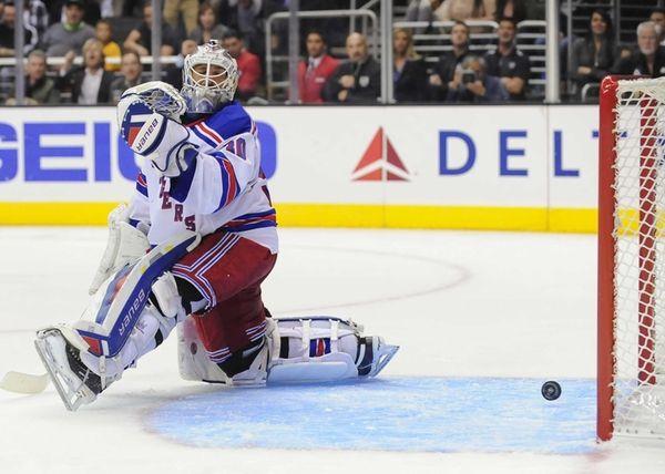 Rangers goalie Henrik Lundqvist watches a goal by