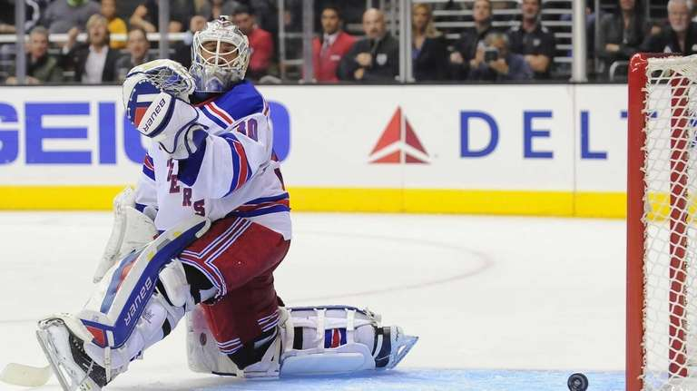 Rangers goalie Henrik Lundqvist watches a goal by