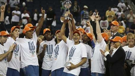 The Minnesota Lynx celebrate their 86-77 win against