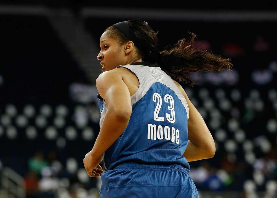 Maya Moore of the Minnesota Lynx runs down
