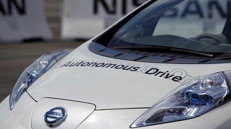 The Nissan Autonomous Drive Leaf electric vehicle sits