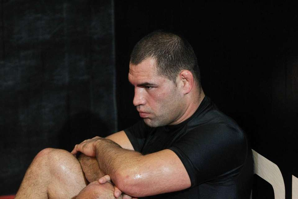 UFC fighter Cain Velasquez rests during a media