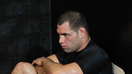 UFC fighter Cain Velasquez rests during a media