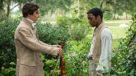 Benedict Cumberbatch, left, and Chiwetel Ejiofor in a
