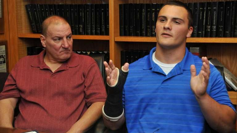 Billy Andrle, right, with his dad William, speak