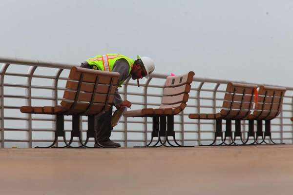 Workers put the finishing touches on the boardwalk
