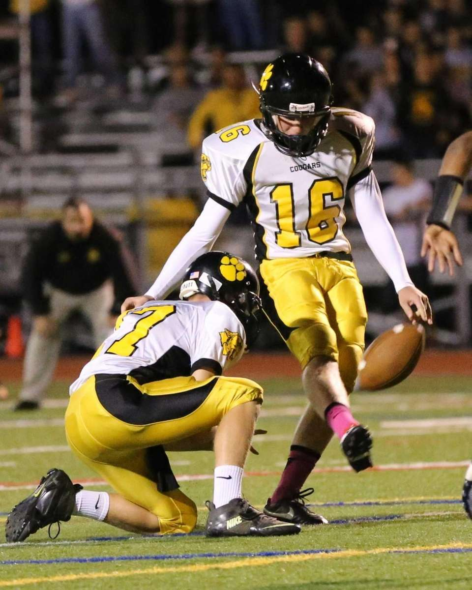 Commack placekicker Billy Holscher boots the extra point