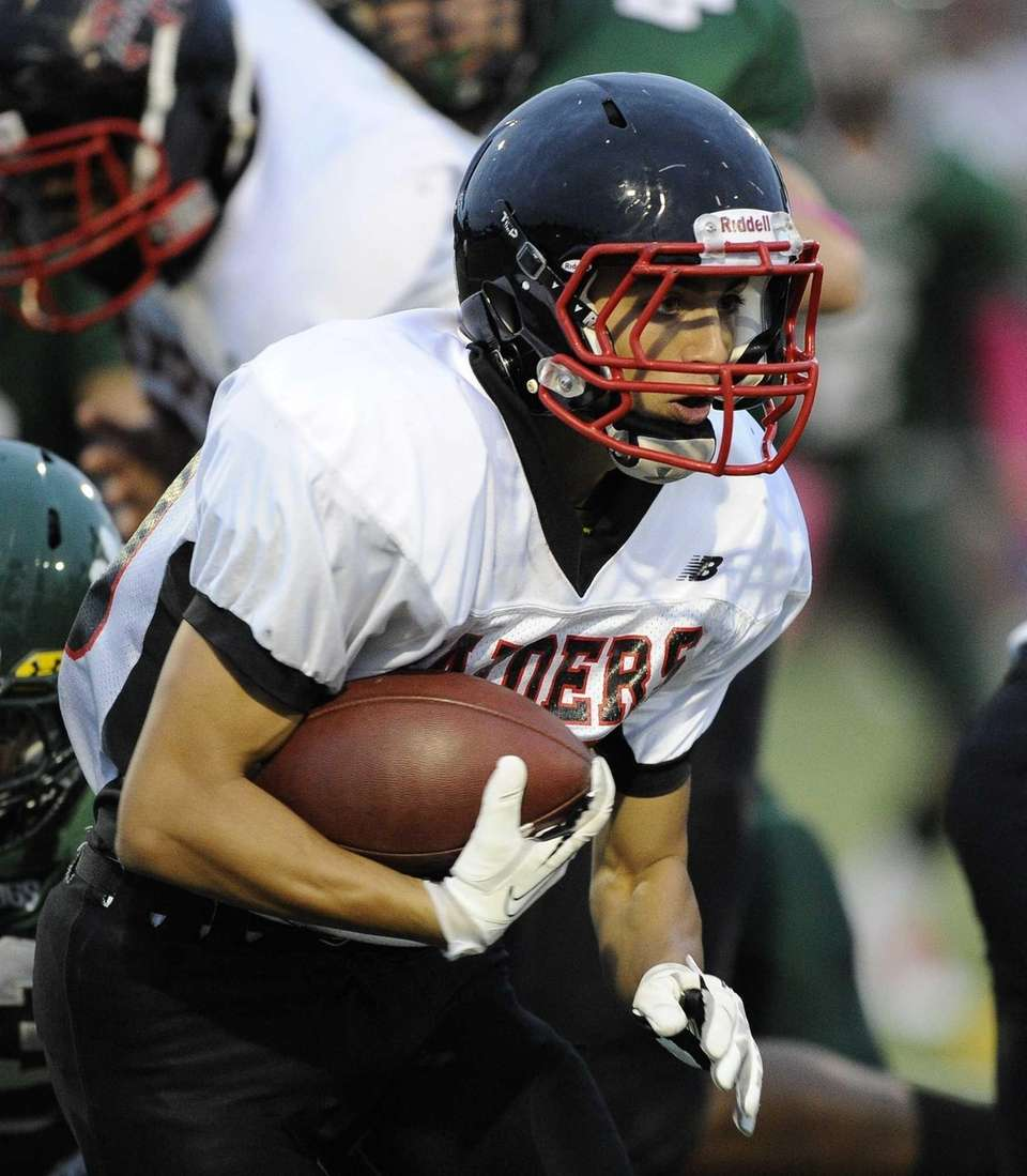 Patchogue-Medford Raiders running back Dominick Cassella carries the