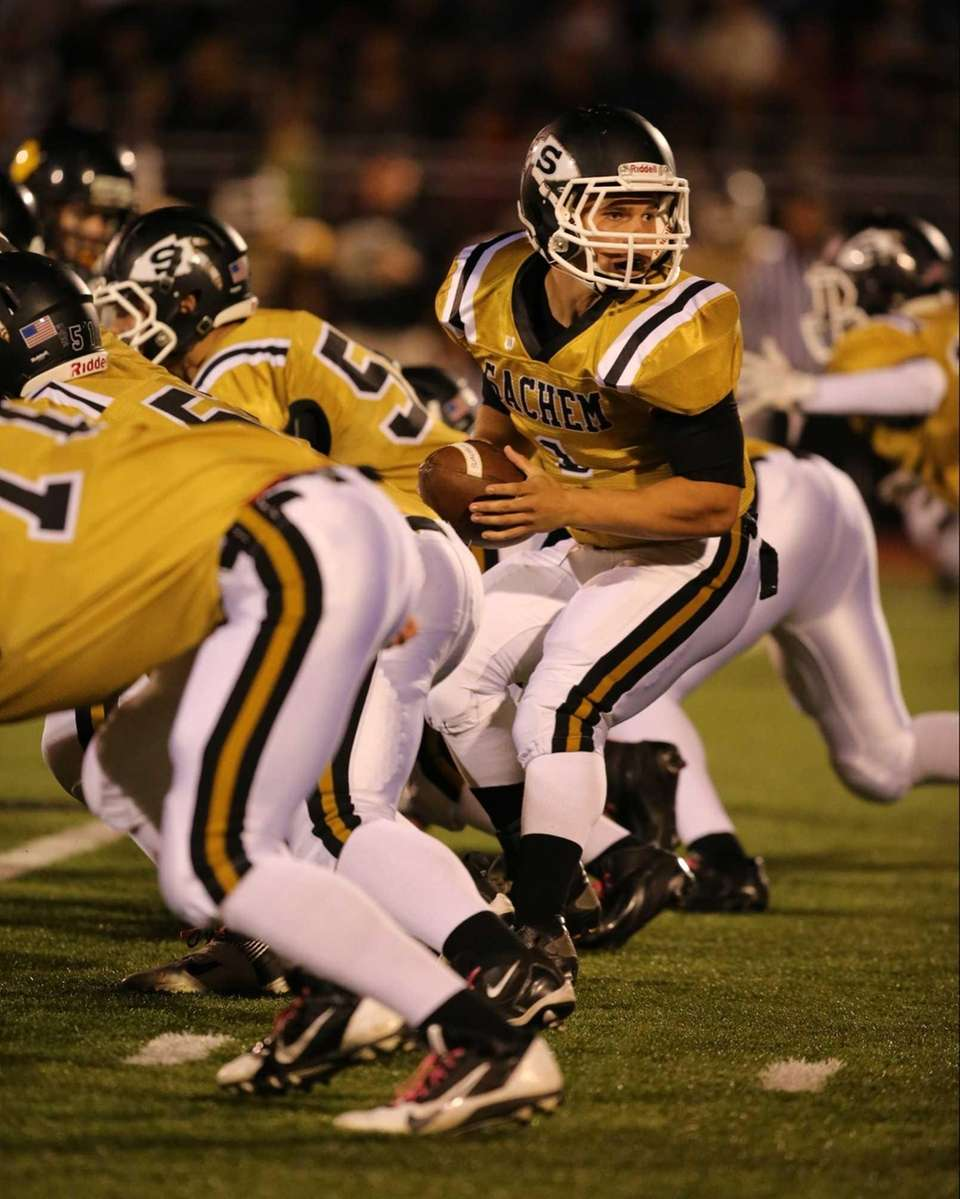 Sachem North quarterback Trent Crossan drops back to
