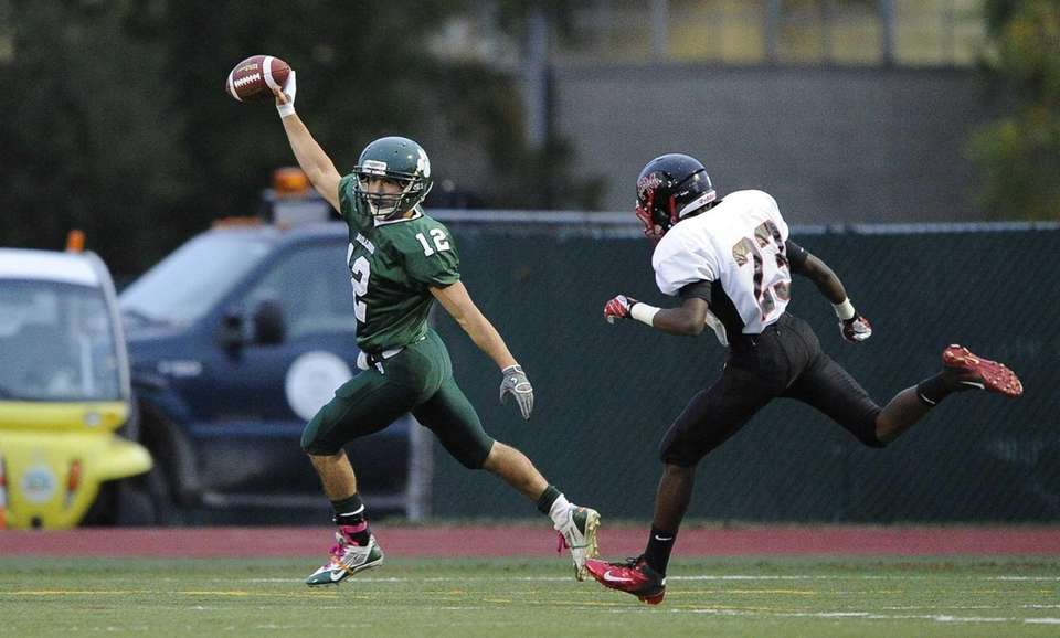 Lindenhurst Bulldogs' Peter Mangione returns the opening kickoff