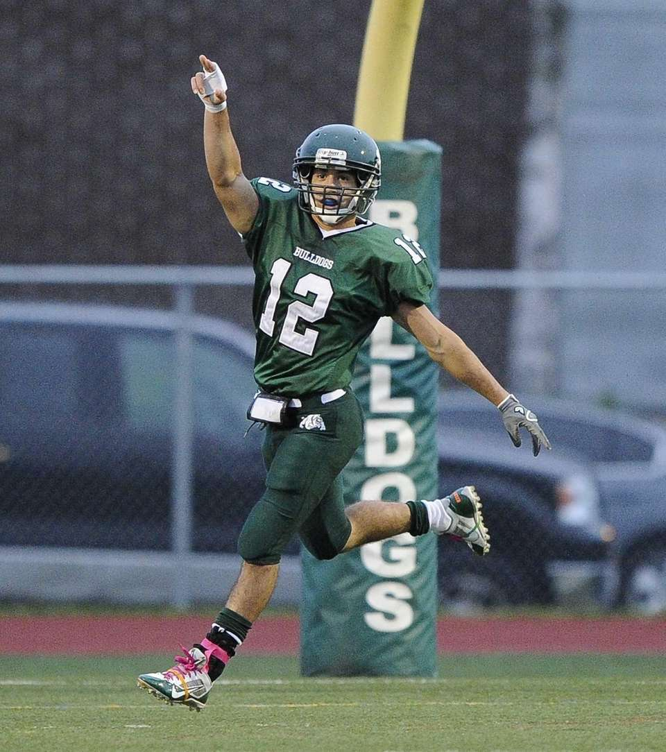 Lindenhurst Bulldogs' Peter Mangione reacts after he returns