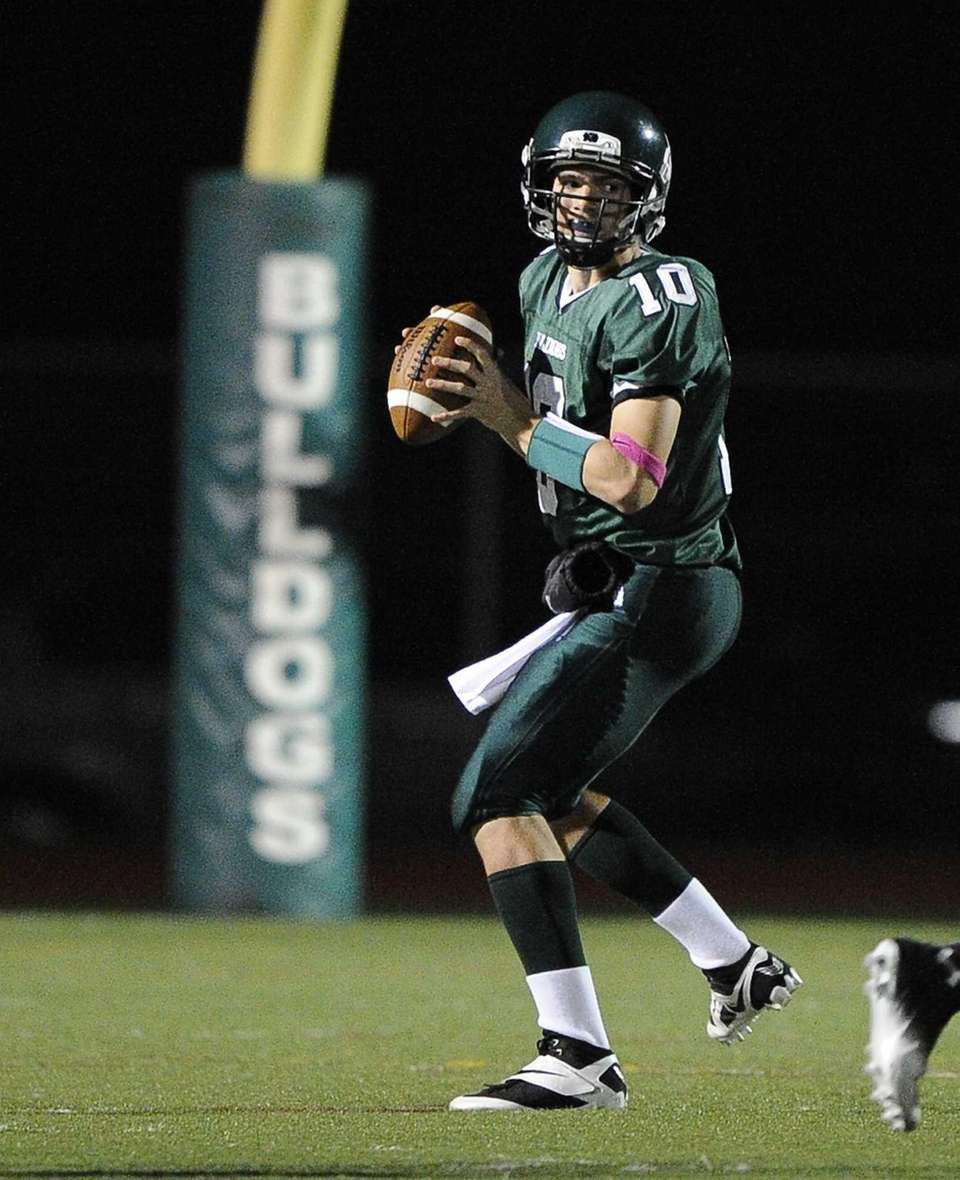 Lindenhurst Bulldogs quarterback Ryan Hofmann steps back to