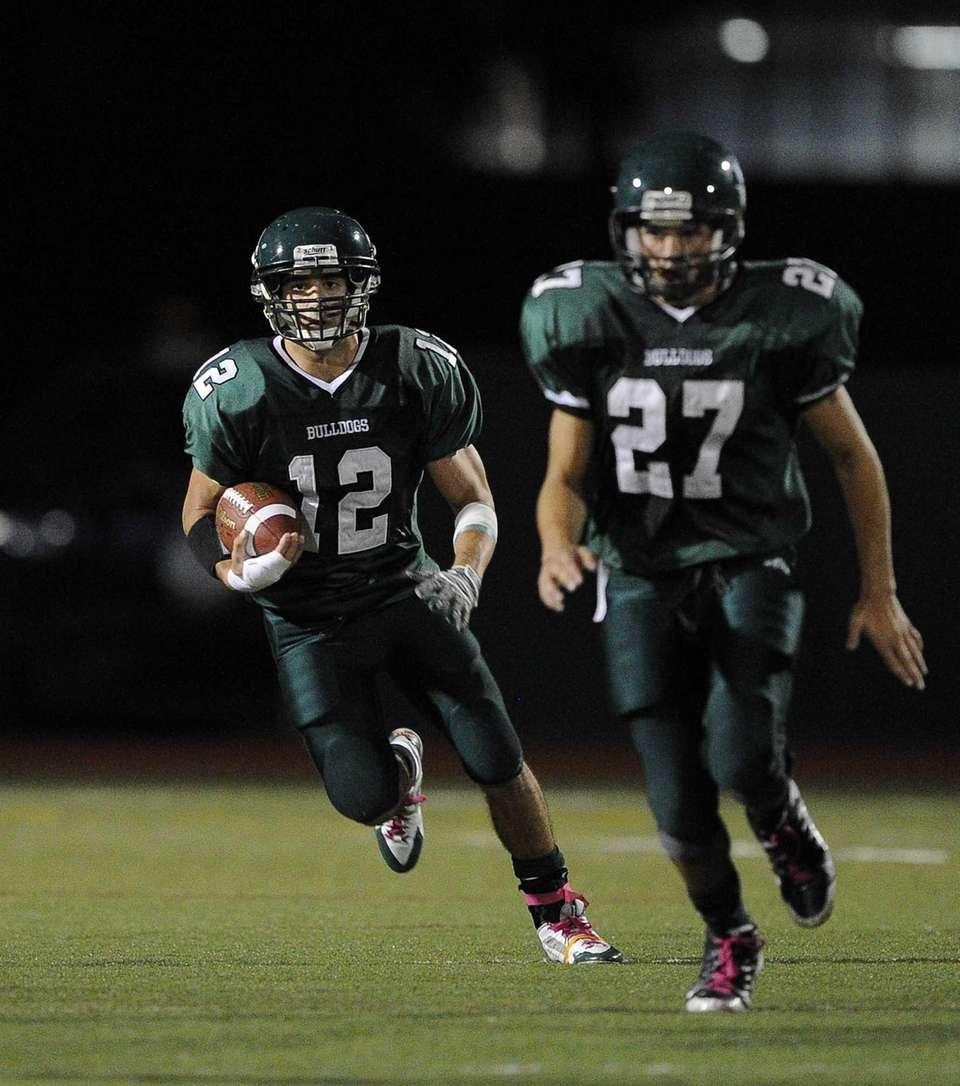 Lindenhurst Bulldogs' Peter Mangione drives the football against
