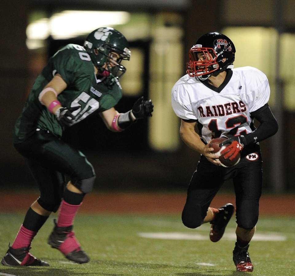 Patchogue-Medford Raiders quarterback Anthony Lee runs the ball