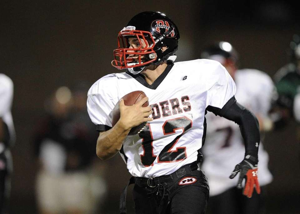 Patchogue-Medford Raiders quarterback Anthony Lee runs the football