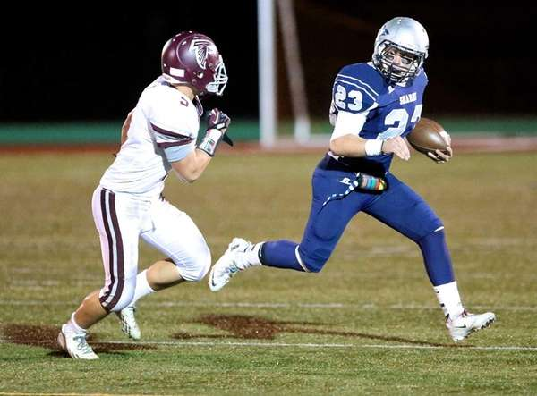 Eastport-South Manor running back Cole Zeller goes to