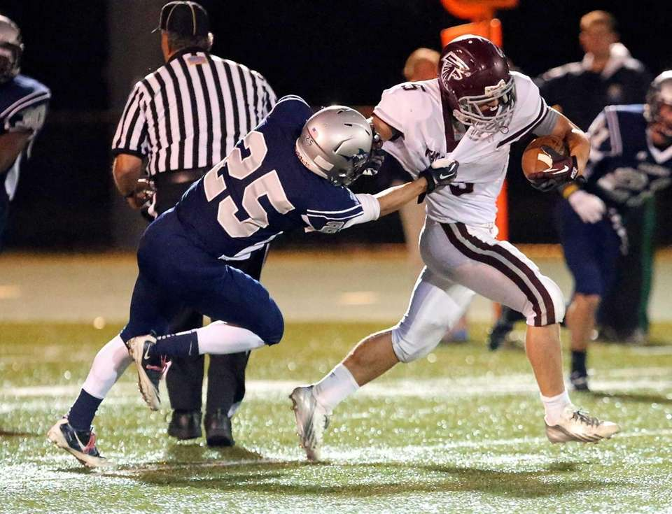 Deer Park fullback Kyle Lessick breaks the Eastport-South