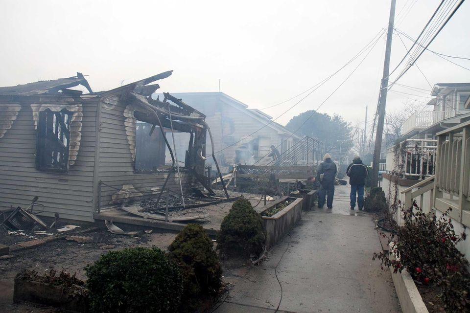 Buildings still burn along Jamaica Walk in Breezy
