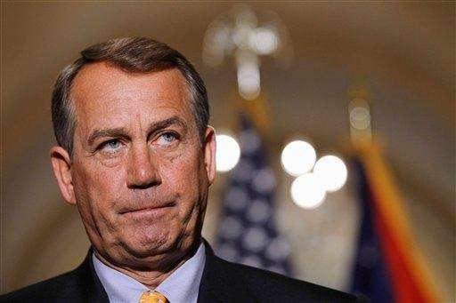 House Speaker John Boehner of Ohio pauses during