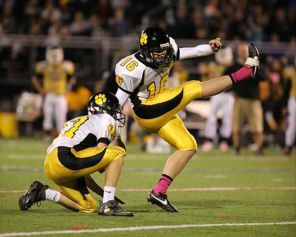 Commack placekicker Billy Holscher kicks the winning field
