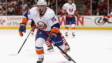 Cal Clutterbuck of the Islanders skates to the