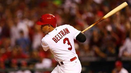 Carlos Beltran of the St. Louis Cardinals hits