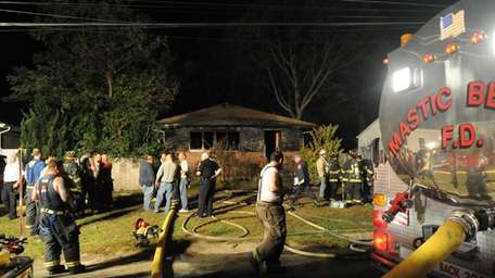 Fire department officials respond to the scene of