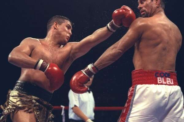 Hector Camacho delivers a blow to the head