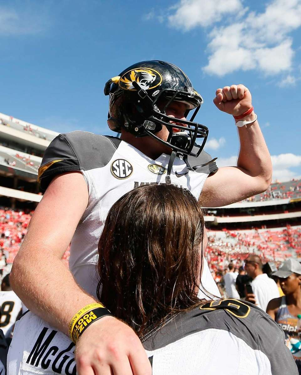 Missouri quarterback Maty Mauk (top) celebrates his team's