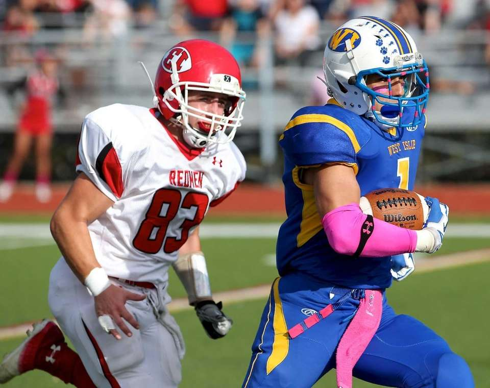 West Islip running back Mike Moynihan runs for