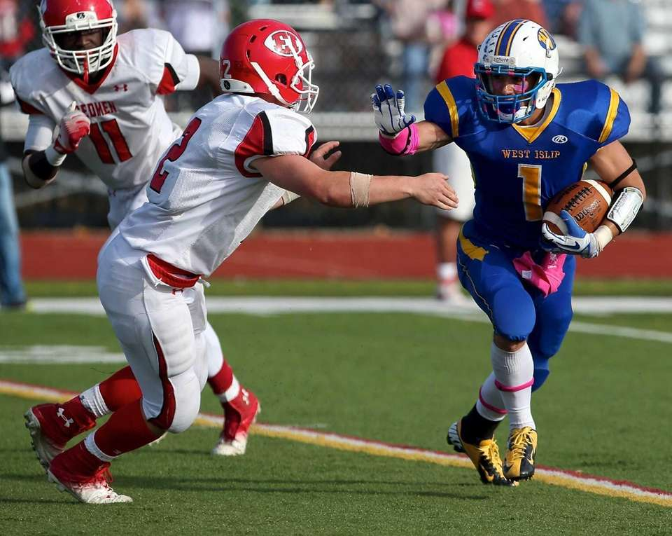 West Islip running back Mike Moynihan looks to