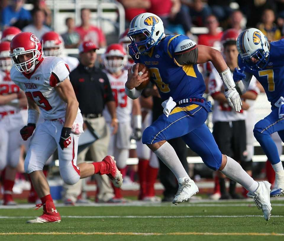 West Islip quarterback Sam Ilario takes the ball
