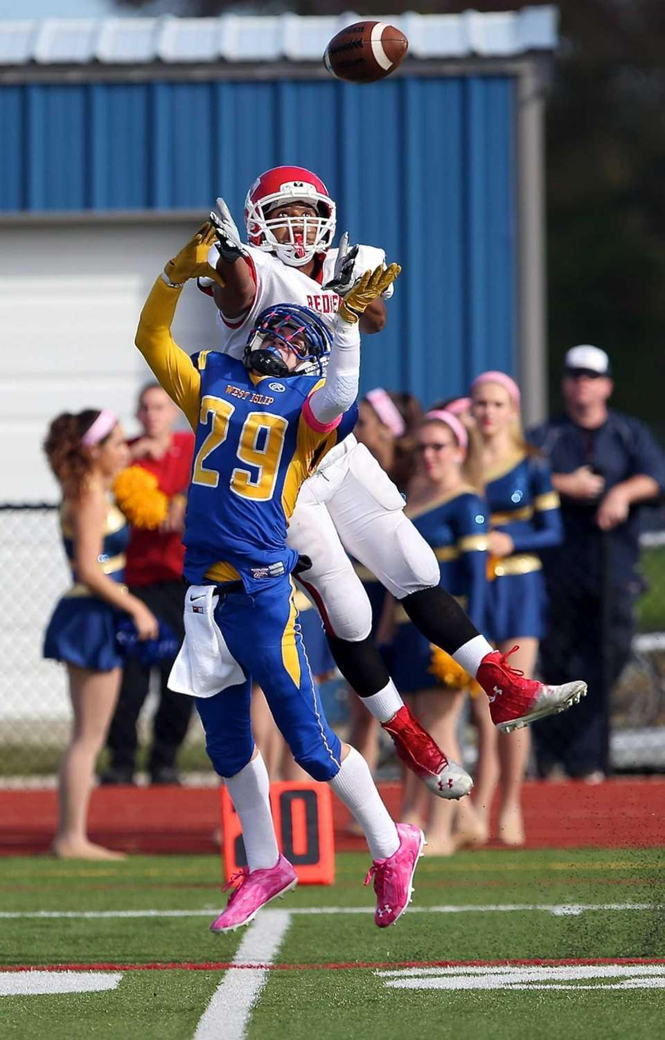 East Islip wide receiver Tranquille Hugens can't grab