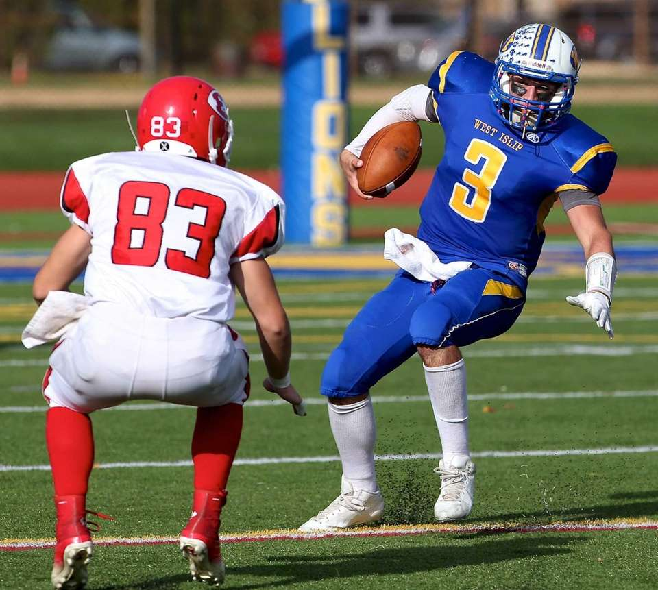 West Islip quarterback Sam Ilario looks to get