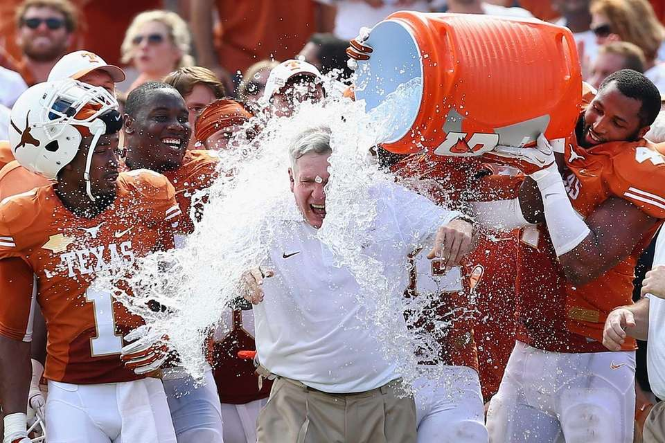 Texas head coach Mack Brown has a cooler