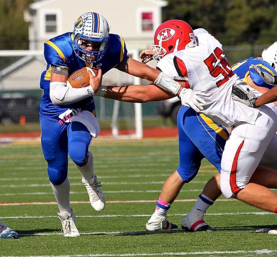 West Islip quarterback Sam Ilario finds the hole