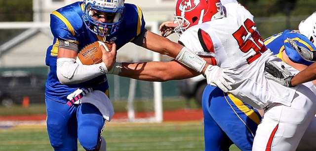 West Islip quarterback Sam Ilario finds the hole