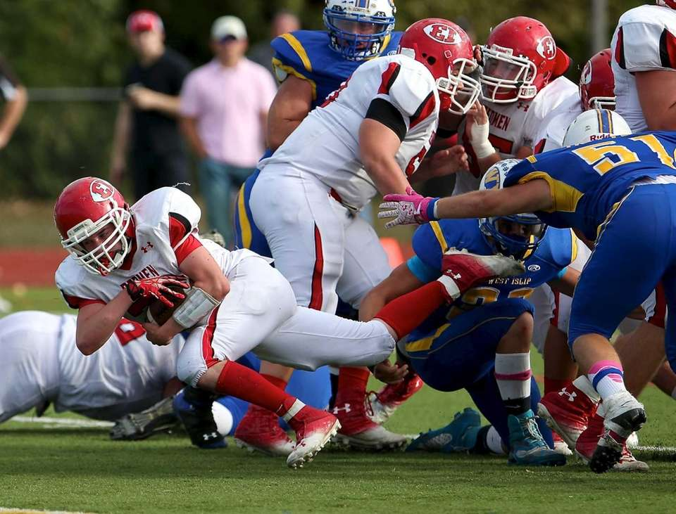 East Islip running back Sean Karika picks up
