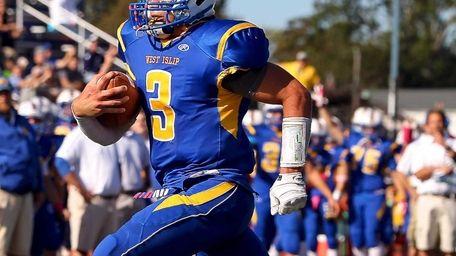 West Islip quarterback Sam Ilario goes in for