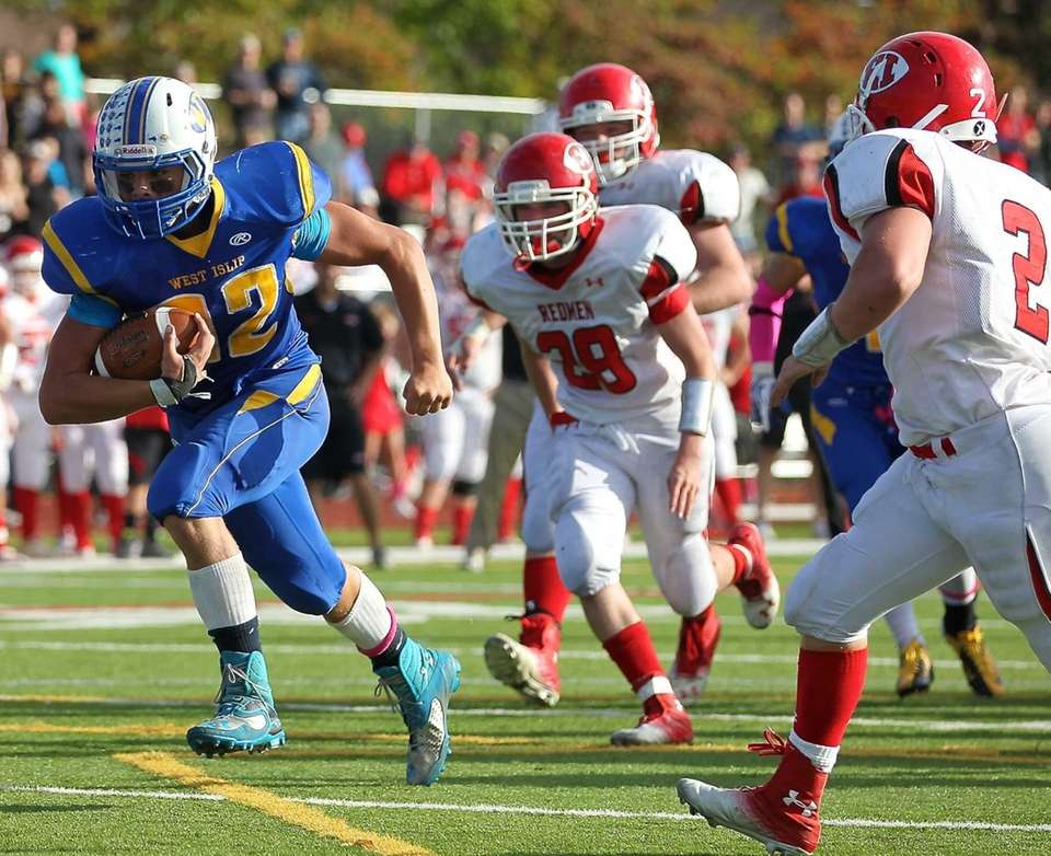 West Islip running back Matt McKeon heads upfield
